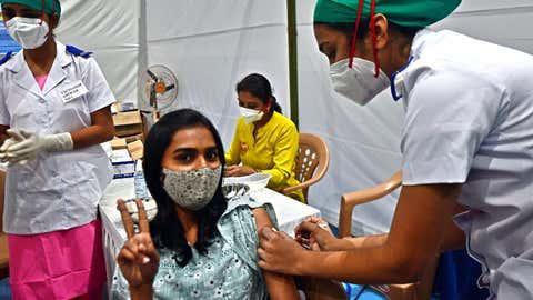A frontline worker receives a dose of Covishield at the Nesco Jumbo vaccination centre at Goregaon in Mumbai. (Uma Kadam/TOI, BCCL, Mumbai)