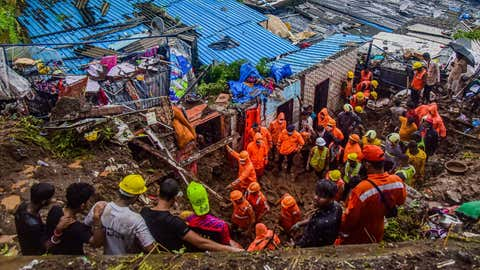 Rescuers look for survivors after a wall collapsed on several slum houses during heavy monsoon rains in the Mahul area of Mumbai, India, Sunday, July 18, 2021. (Kaushik Naik/TOI, BCCL, Mumbai)
