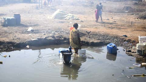 A woman fills water from the broken valve, developed on the water supply pipeline at Nakshatrawadi, Paithan road in Aurangabad. (Snehil Sakhare/TOI, BCCL, Aurangabad)