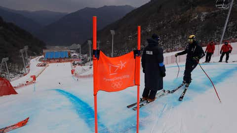 Skiers stand on the course before a men's downhill training run at the 2018 Winter Olympics in Jeongseon, South Korea, Friday, Feb. 9, 2018. (AP Photo/Luca Bruno)