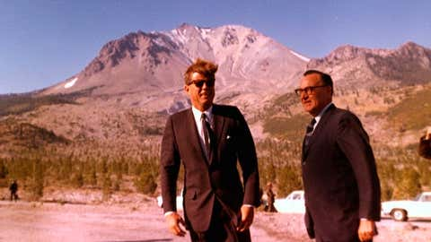 """President John F. Kennedy with Governor Edmund Brown at the Devastated Area of Lassen Volcanic National Park on September 28, 1963. The visit was part of Kennedy's five-day """"conservation tour"""" of eleven states from Pennsylvania to California, designed to promote environmental awareness. (Cecil Stoughton/White House Photographs, John F. Kennedy Presidential Library and Museum, Boston, via NPS.gov)"""