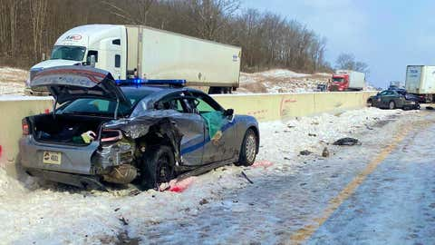 Two Kentucky State Police troopers where injured when their cars were hit while they worked at a crash scene on Interstate 65 near Horse Cave, Kentucky, on Tuesday, February 16, 2021. (Twitter/@kystatepolice)