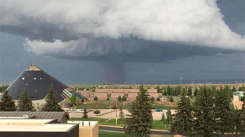A tornado north of Laramie, Wyoming, is seen from the University of Wyoming's War Memorial Stadium in Laramie on June 6, 2018. (Amber and Chris Klemt/Facebook)
