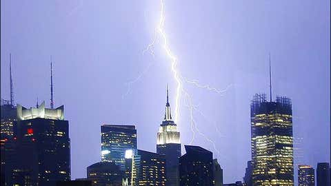 Lightning strikes the Empire State Building and other buildings during a thunderstorm in New York City.
