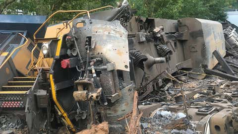 Two people on a train that derailed early Sunday, October 11, 2020, in Lilburn, Georgia. The conductor and engineer had non-life threatening injuries and were taken to a hospital, according to fire officials. (Twitter/@GwinnettFire)
