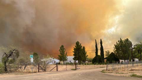 Smoke from the Margo Fire in Dudleyville, Arizona, turned the sky orange on Thursday, April 8, 2021. (Pinal County Sheriff's Office via Twitter)