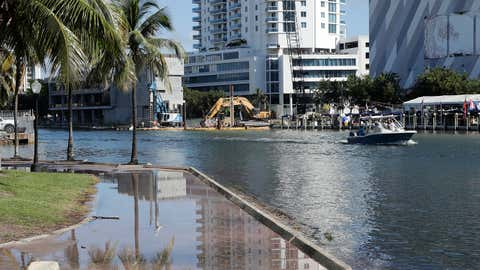 A pedestrian walkway along the Miami River is flooded during a king tide, Saturday, September 28, 2019, in Miami. Flooding threatens tens of thousands of septic tank systems in Miami-Dade County. (AP Photo/Lynne Sladky). (AP Photo/Lynne Sladky)