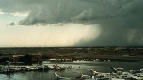 Rain-cooled air from a thunderstorm crashes to the ground in the form of a downburst near Denver's former Stapleton International Airport, one of the main sites where microburst warning systems were developed and tested. (UCAR Digital Image Library)
