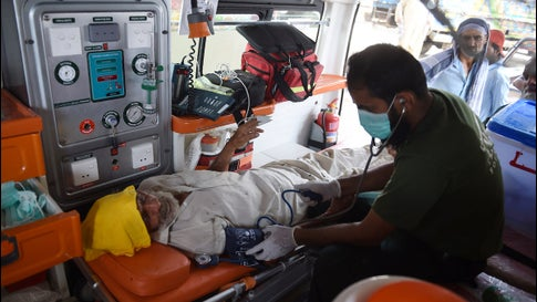 A Pakistani paramedic treats a heat stroke victim in an ambulance during a heatwave in Karachi on May 31, 2018. Pakistan saw the highest temperature ever reliably recorded in Asia during the month of April when it hit 50.2°C (122.4°F) at Nawabshah on April 30