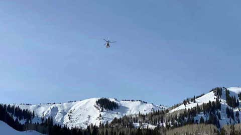 A helicopter flies over the area where an avalanche occurred in the backcountry outside of the Park City Mountain Resort ski area on Friday, Jan. 8, 2021. A man who ventured outside of the resort to snowboard was killed in the avalanche. (Park City Fire District via Facebook)