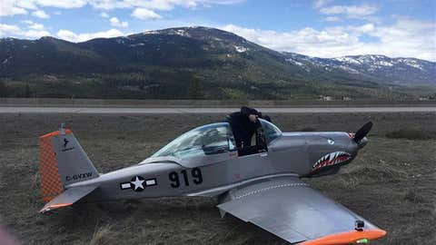 A Mustang II plane sits on the ground after landing between a divided highway near Merritt, B.C. on Sunday, April 22, 2018. THE CANADIAN PRESS/HO-Debra Sharkey MANDATORY CREDIT