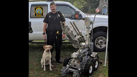 Master Police Officer David Hurt is seen with his police dog Turbo. Hurt was suspended without pay for five days after Turbo died from excessive heat in July 2018 when the dog was left in a police vehicle for more than six hours. (Columbia, S.C. Police Department via AP)