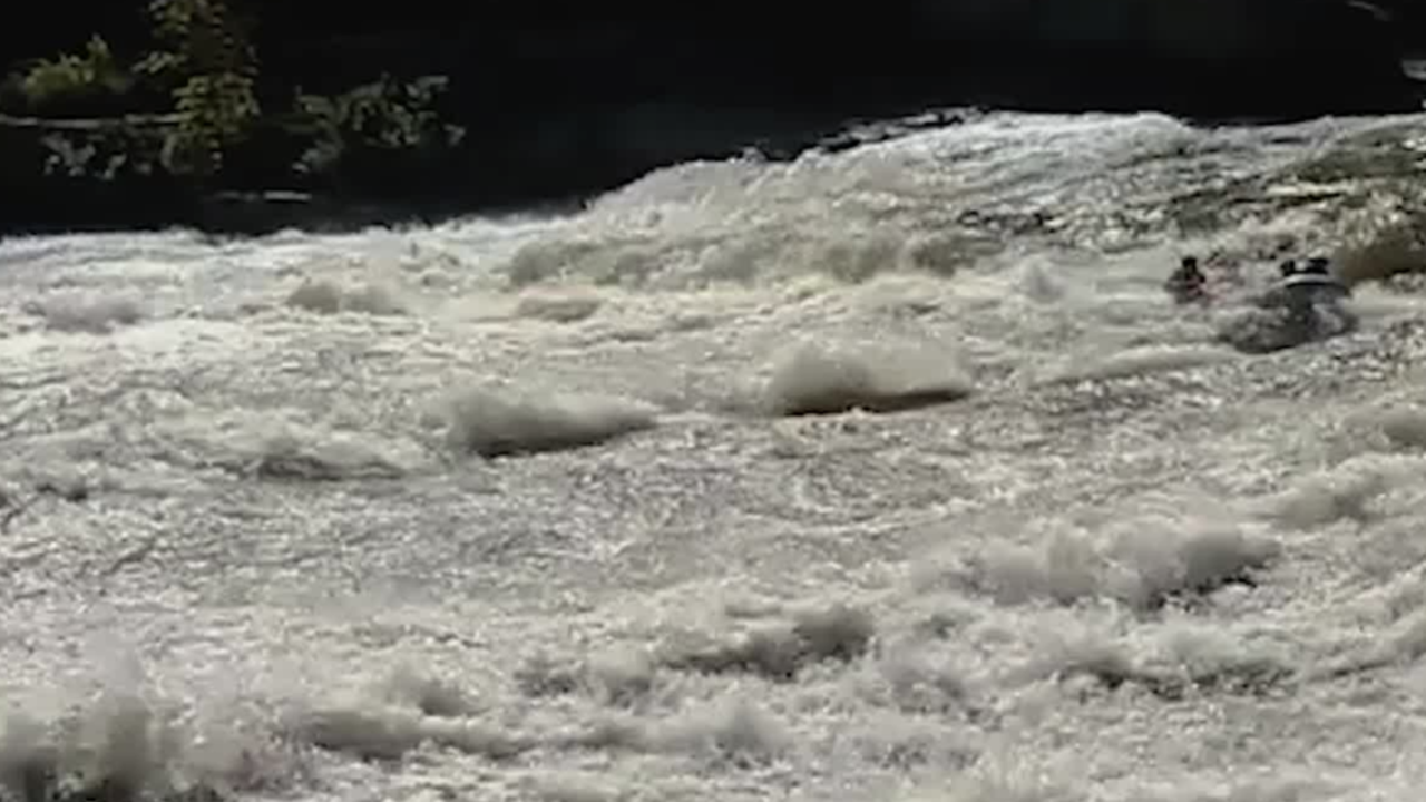 Rafters Miss Warning Sign, Plunge Over Waterfall