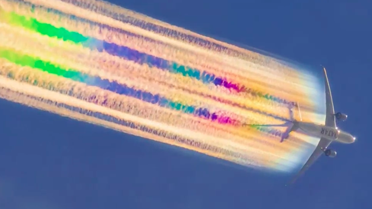Plane Leaves Rainbow-Colored Trail in the Sky