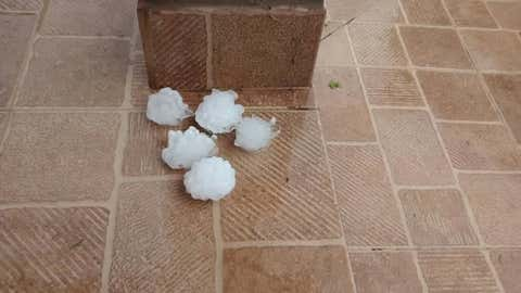 Large hailstones are seen following a severe storm on Thursday, Feb. 8, 2018 in Cordoba province, Argentina. (Roberto Boccardi)