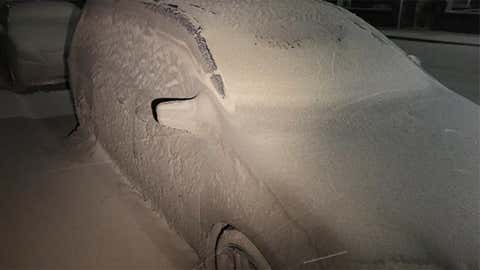 Windblown sand mixed with rain from the weekend nor'easter blasted cars along the Massachusetts coast. This car was in Marshfield, Massachusetts. (Twitter/@irisup)