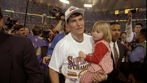 Quarterback Mark Rypien of the Washington Redskins holds his daughter after Super Bowl XXVI against the Buffalo Bills at the Hubert Humphrey Metrodome in Minneapolis, Minnesota. The Redskins defeated the Bills 37-24. (Rick Stewart/Getty Images)