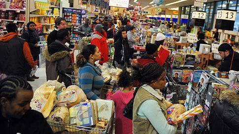 People crowd a Giant food store for supplies ahead of the forecasted snowstorm in Silver Spring, Maryland, on February 9, 2010. Already paralyzed after an epic weekend blizzard, the northeast US including the capital Washington braced on February 9, for a second storm set to dump enough snow to smash all-time winter records. AFP PHOTO/Jewel SAMAD (Photo credit should read JEWEL SAMAD/AFP via Getty Images)