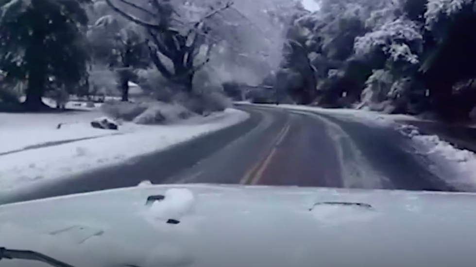 Watch: Frightening Close Call on Snowy California Road