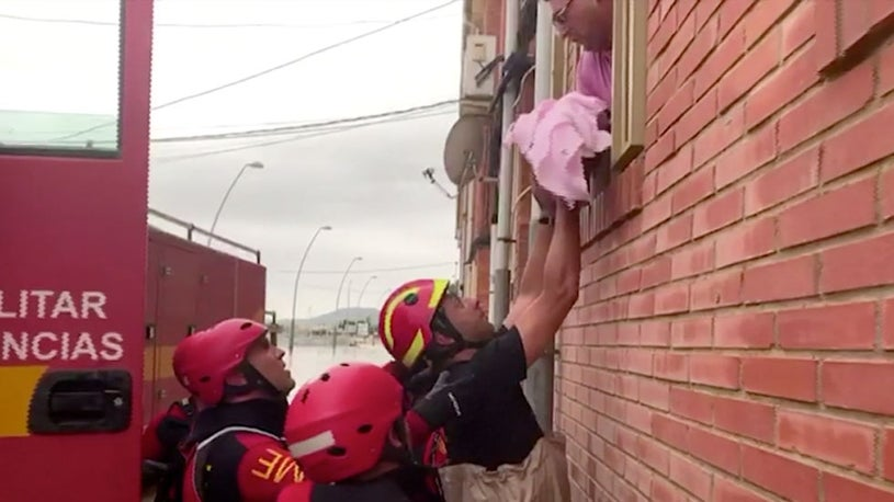 Baby and Young Children Carried Out of Floodwaters in Spain
