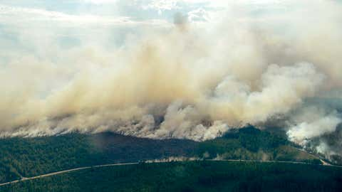 In this aerial photo showing the advancing fire around Ljusdal, Sweden, as a wildfire sweeps through the large forest area Wednesday July 18, 2018. Dry weather has endangered large tracts of forest and many residential areas.(Maja Suslin/Lehtikuva via AP)
