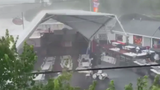 South Carolina Storm Sends Tent Flying with Two People Hanging On