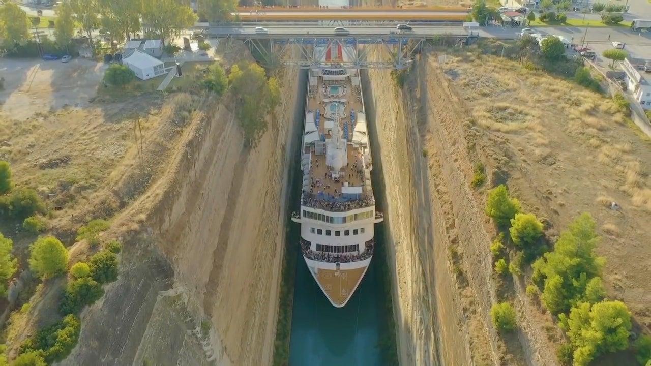 Massive Cruise Ship Squeezes Through Narrow Greek Canal