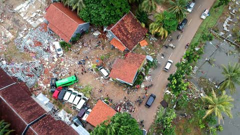 An aerial photo shows damaged buildings in Carita on December 23, 2018, after the area was hit by a tsunami on December 22 following an eruption of the Anak Krakatoa volcano. - A volcano-triggered tsunami has left at least 168 people dead and hundreds more injured after slamming without warning into beaches around Indonesia's Sunda Strait, officials said on December 23, 2018 voicing fears that the toll was set to rise. (Photo by Azwar Ipank / AFP) (Photo credit should read AZWAR IPANK/AFP/Getty Images)