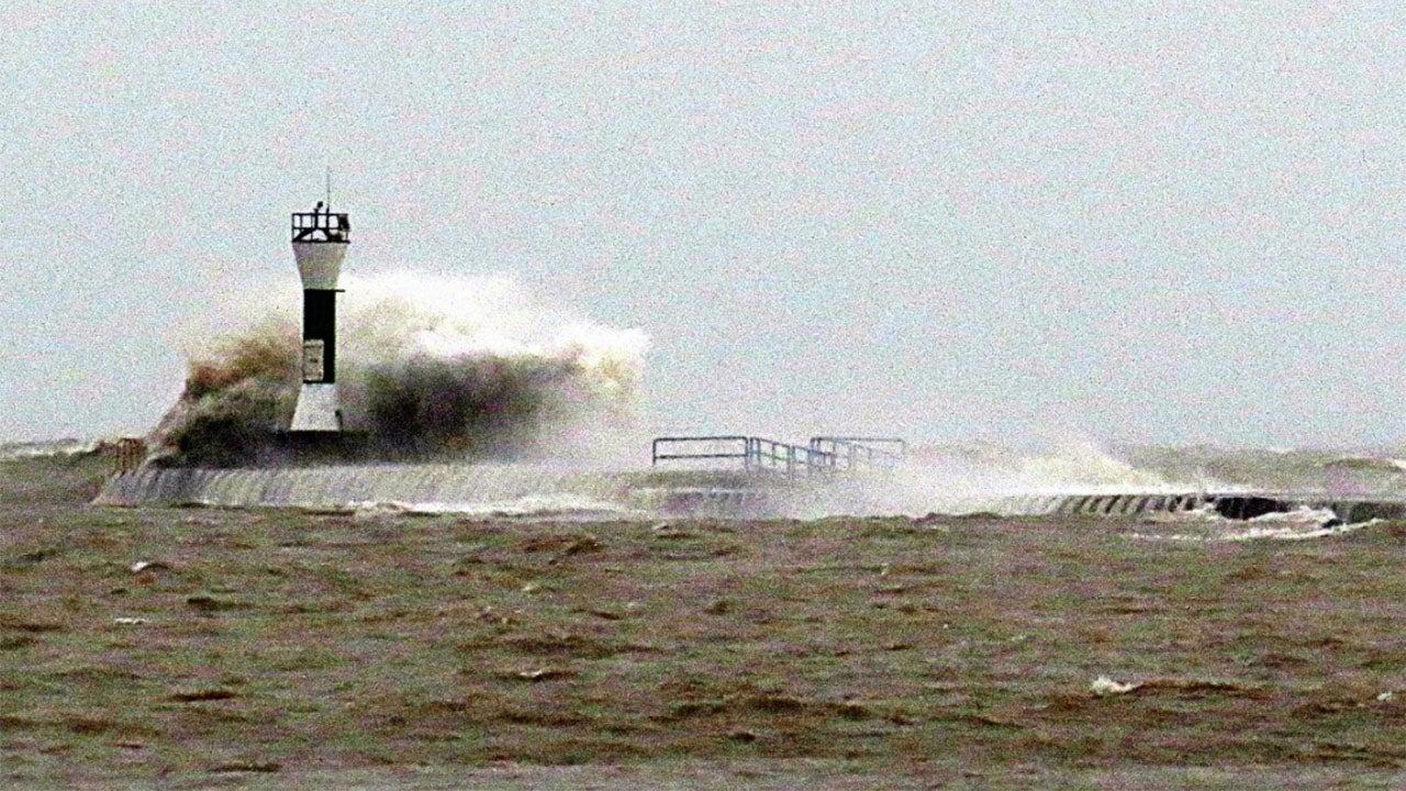 Giant Wave Knocks 20-Foot-Tall Beacon into Lake Michigan