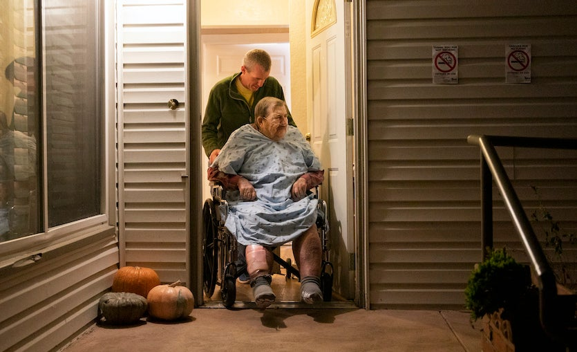 Henry Provencher, 87, is wheeled out of Redwood Retreats, a residential care facility by owner Eric Moessing while evacuating due to the Kincade Fire in Santa Rosa, Calif., on Saturday, Oct. 26, 2019