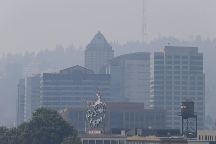 Downtown skyline of Portland, OR, shrouded in smoke on Thurs. 8/3/2017