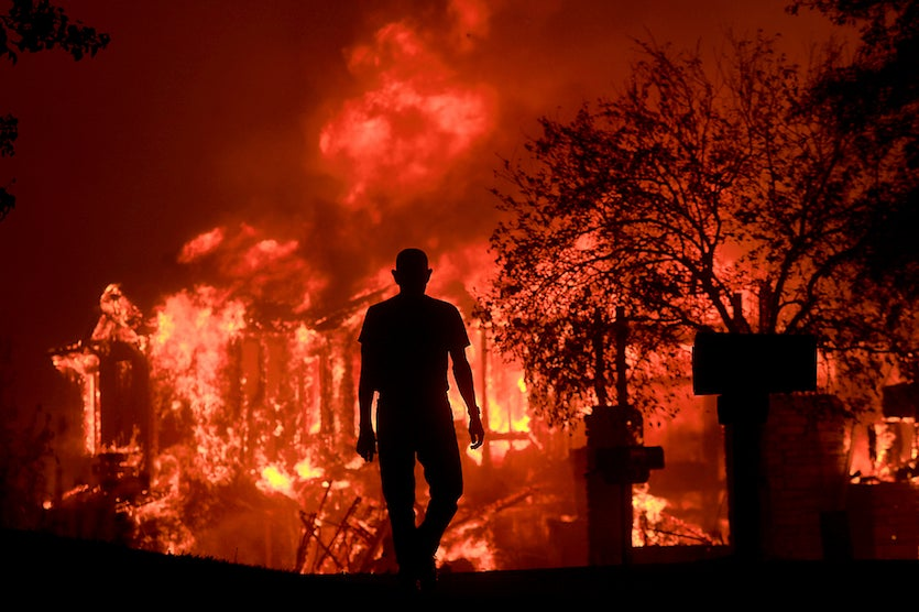 Jim Stites watches part of his neighborhood burn in Fountaingrove, Calif., just north of Santa Rosa, on Monday, Oct. 9, 201