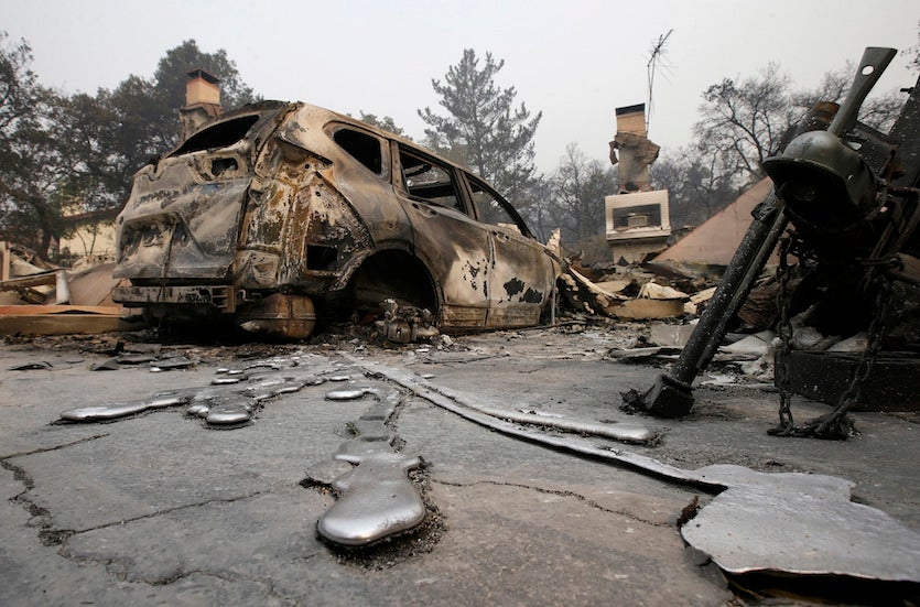 Rivers of melted metal flow from a vehicle parked at a home, Tuesday, Oct. 10, 2017, that was destroyed by a wildfire near Napa, Calif