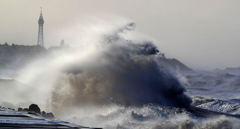 Massive waves crash over seawalls in Blackpool, northwest England, on Wed., Jan 3, 2018