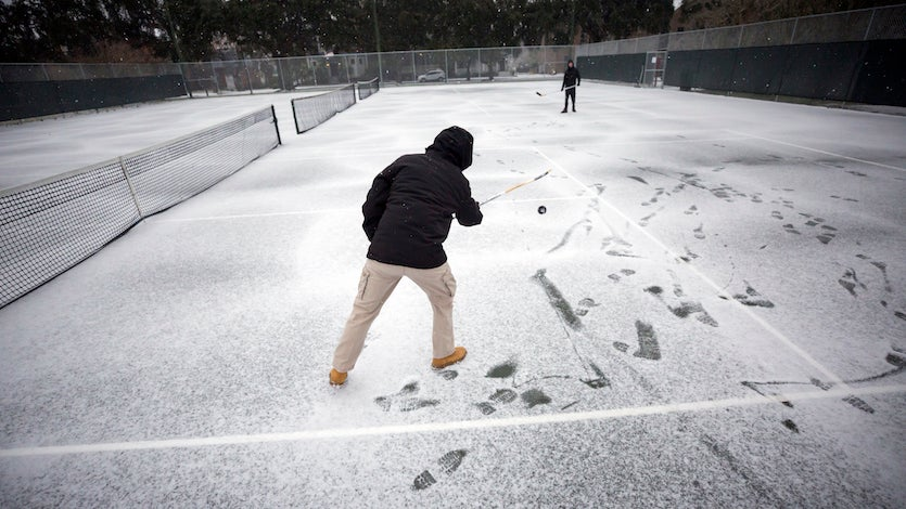 Vincent Sottile, center, and his brother Mike Sottile play hockey on the public tennis courts at Forsyth Park in Savannah, GA, on Wednesday, Jan. 3, 2018