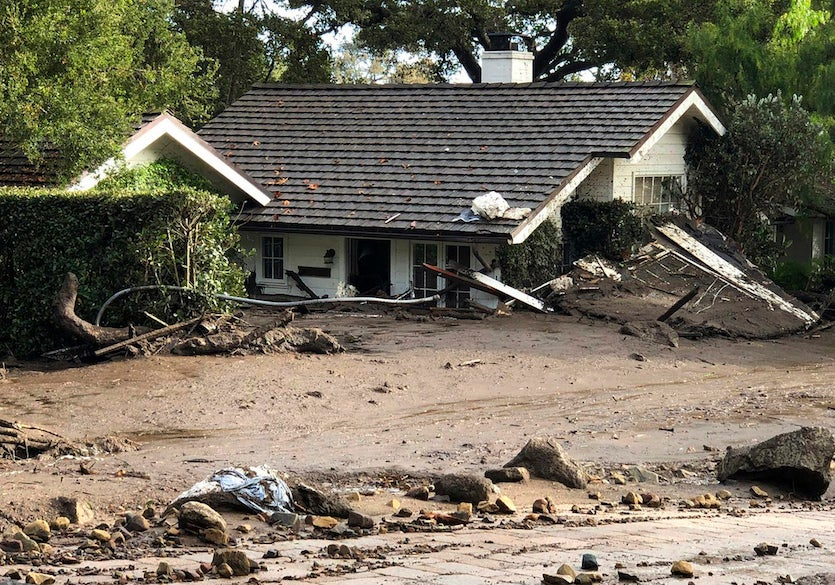 A home buried in flood debris in Montecito, Calif., Tuesday, Jan. 9, 2018