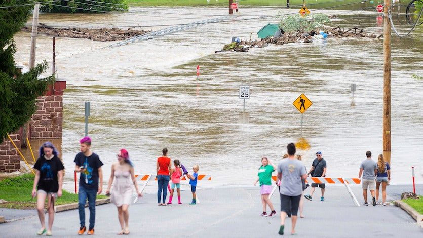 Swatara Creek flooding envelops the Duke Street Bridge in Hummelstown near Hershey, Pennsylvania, on Wednesday, July 25, 2018