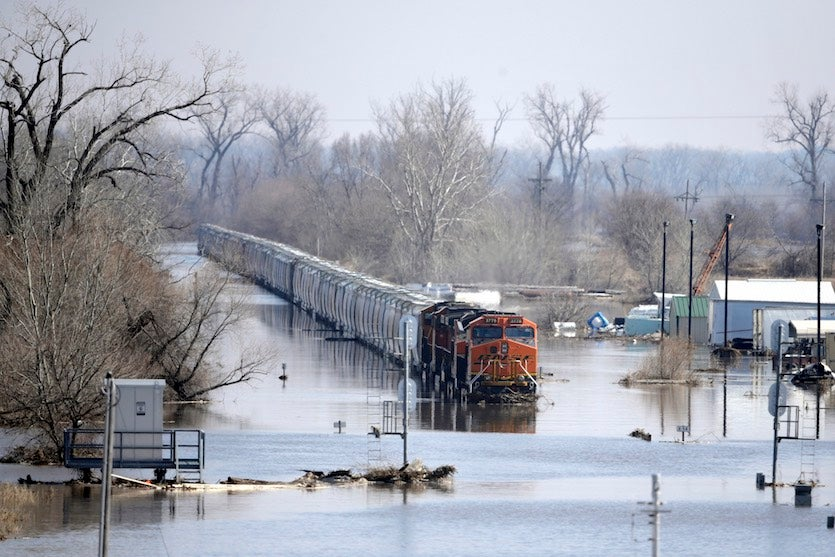 A BNSF train sits in flood waters from the Platte River, in Plattsmouth, Neb., on Sunday, March 17, 2019