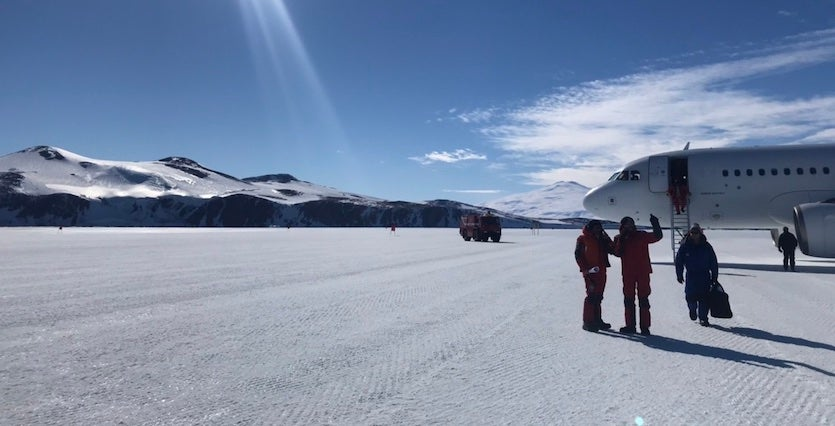 Disembarking on the snow runway constructed on the sea ice of Terra Nova Bay, Antarctica