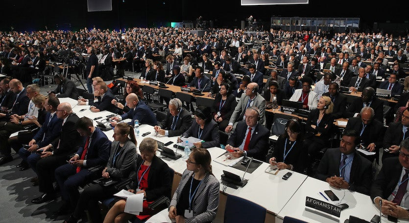 Delegates attend the opening ceremony of the COP 24 United Nations climate change conference on December 03, 2018, in Katowice, Poland