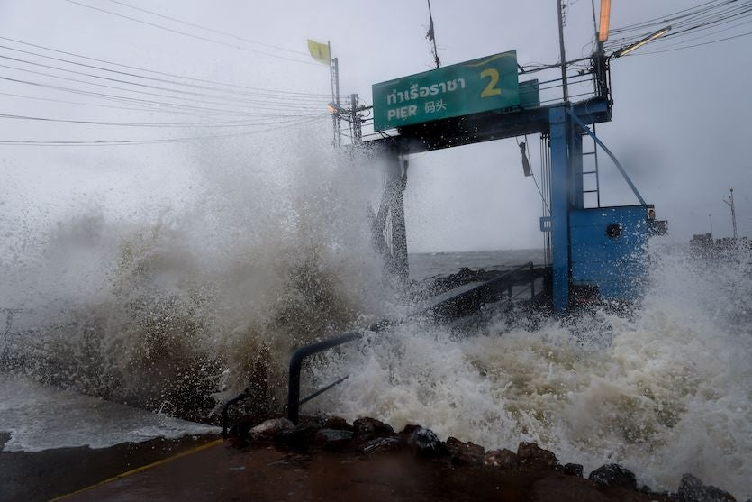 Waves from Tropical Storm Pabuk crash into a pier in the southern Thai province of Surat Thani on Friday, January 4, 2019