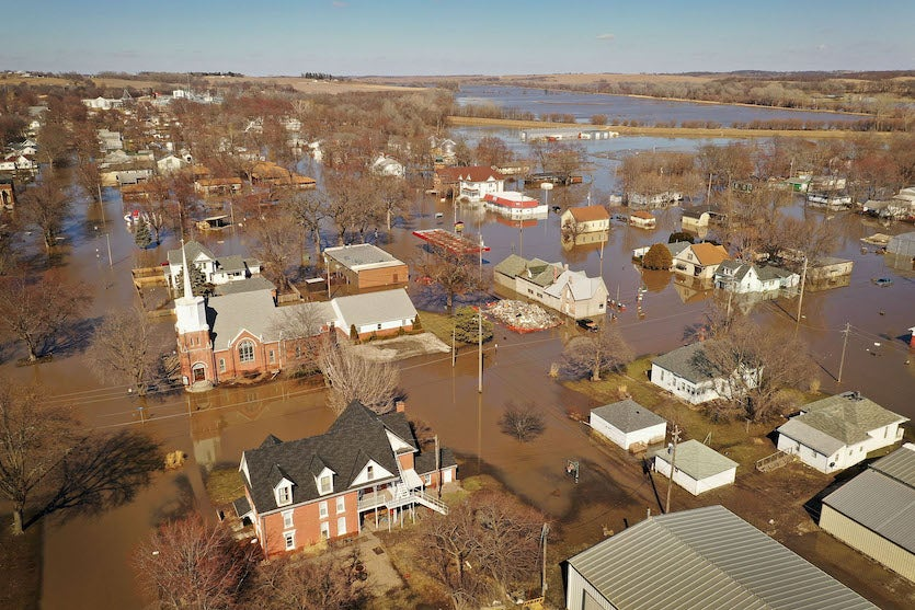 Homes and businesses are surrounded by floodwater on March 20, 2019, in Hamburg, Iowa