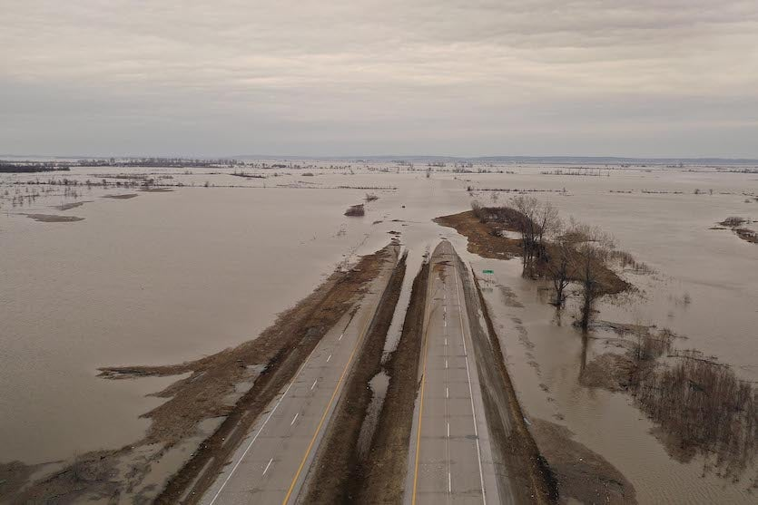 Floodwater covers Highway 2 on March 23, 2019, near Sidney, Iowa.