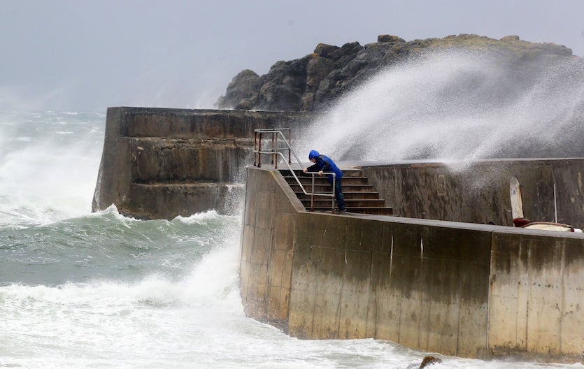 Waves break over the sea wall along Portstewart harbour in Portstewart, Northern Ireland, as the remnants of Hurricane Katia hit the British shores, on September 12, 2011