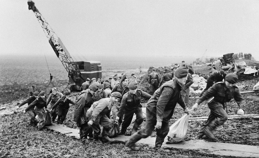 Soldiers working on flood defenses, Netherlands, 1953