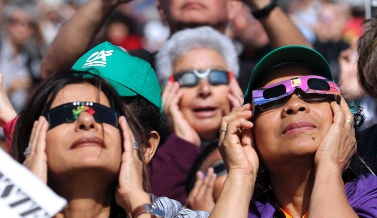 People viewing an annular solar eclipse with eye protection at La Reunion, 9/1/2016