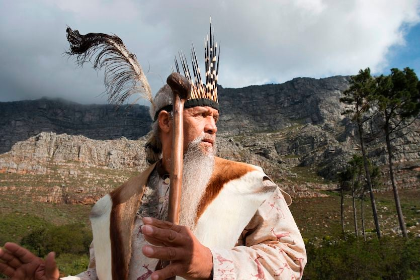 Khoisan leader Ockert Lewies begins a prayer for rain at the foot of Table Mountain, on May 25, 2017, in Cape Town, South Africa