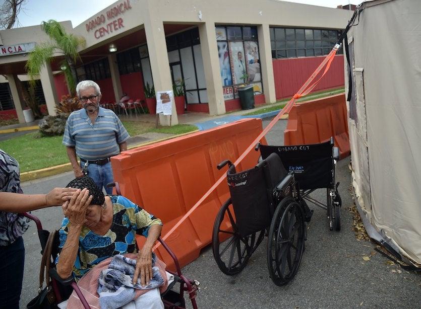Angelina Rodriguez Lopez (left) waits for medical attention at a temporary facility set up near Dorado Medical Center, Puerto Rico.