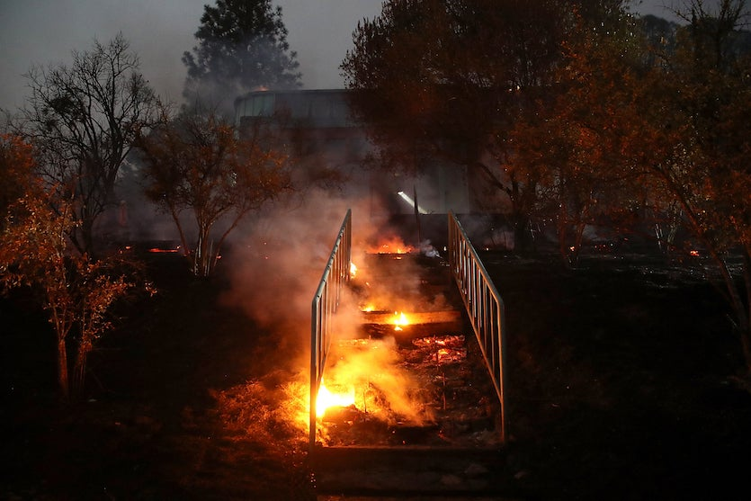A stairwell smolders as a home burns during the Tubbs Fire on October 12, 2017 near Calistoga, California.