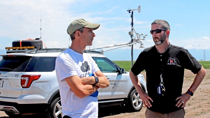 Adam Houston (right) with a colleague on a research storm chase
